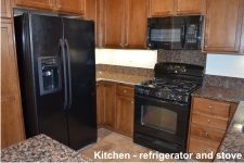Kitchen refrigerator and stove